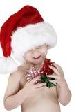 Het kind van de kerstman met Kerstmisbogen Royalty-vrije Stock Afbeelding