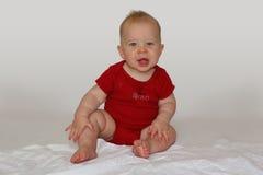 Het kind van de zitting Stock Foto