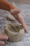 Het kind van het aardewerk stock foto's