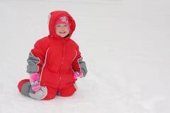 Het kind van het geluk op sneeuw Royalty-vrije Stock Fotografie