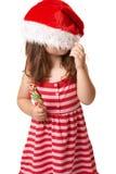 Het kind van Kerstmis met santahoed royalty-vrije stock afbeeldingen