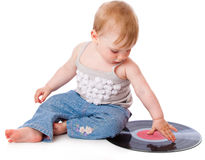 Het kleine kind met een zwarte grammofoonplaat Royalty-vrije Stock Foto's