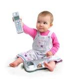 Het kleine kind met telefoon Stock Afbeeldingen