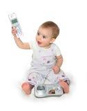 Het kleine kind met telefoon Stock Afbeelding