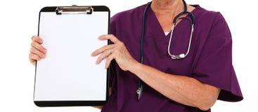 Het Klembord van de Holding van de arts Stock Foto