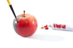 Het kleuren van een echte appel Stock Afbeelding