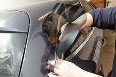 Het kleuren van glas in auto Stock Foto's