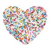 Het kleurrijke die suikergoed bestrooit hart op witte achtergrond wordt geïsoleerdt stock fotografie