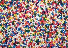 Het kleurrijke Suikergoed bestrooit stock afbeeldingen