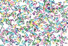 Het kleurrijke suikergoed bestrooit geïsoleerdo op witte achtergrond royalty-vrije stock fotografie