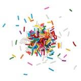 Het kleurrijke suikergoed bestrooit geïsoleerdw op witte achtergrond stock afbeelding