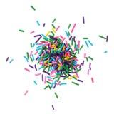 Het kleurrijke suikergoed bestrooit stapel stock afbeelding