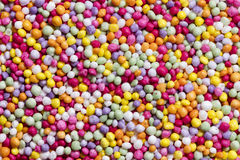 Het kleurrijke Suikergoed bestrooit Volledige Kaderachtergrond royalty-vrije stock afbeeldingen