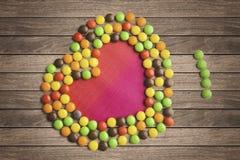 Het kleurrijke suikergoed vormde een hartsymbool Royalty-vrije Stock Foto's