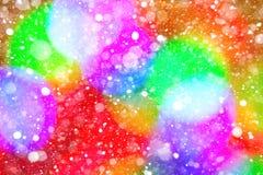 Het kleurrijke vlekken bokeh effect en de sneeuwvlokken Stock Afbeeldingen