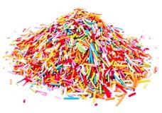 Het kleurrijke Zoete Suikersuikergoed bestrooit geïsoleerd op witte backgrou stock fotografie