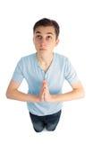 Het knielen in gebed royalty-vrije stock foto