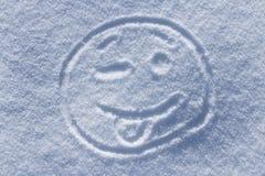 Het knipogen smiley op sneeuw Stock Foto's