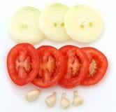 Het knoflook en de tomaten van uien Stock Foto's