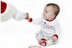 Het koekje van de baby voor Kerstman stock afbeelding