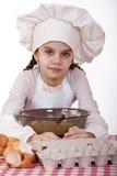 Het koken en mensenconcept - glimlachend meisje in kokhoed Royalty-vrije Stock Foto's