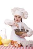 Het koken en mensenconcept - glimlachend meisje in kokhoed Stock Afbeeldingen
