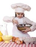 Het koken en mensenconcept - glimlachend meisje in kokhoed Royalty-vrije Stock Afbeeldingen