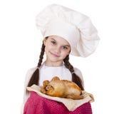 Het koken en mensenconcept - glimlachend meisje in kokhoed Royalty-vrije Stock Afbeelding