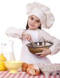 Het koken en mensenconcept - glimlachend meisje in kokhoed Stock Afbeelding