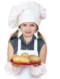 Het koken en mensenconcept - glimlachend meisje in kokhoed Stock Fotografie