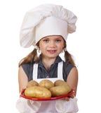 Het koken en mensenconcept - glimlachend meisje in kokhoed Royalty-vrije Stock Fotografie
