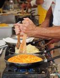 Het koken frico, de typische die Friulian-schotel van verwarmde kaas wordt gemaakt en aardappels royalty-vrije stock foto's