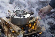 Het koken op brand Stock Foto