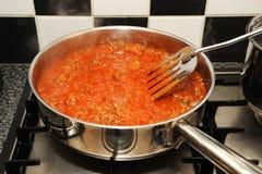 Het koken op Fornuis Stock Foto