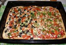 Het koken, pizza Stock Afbeeldingen