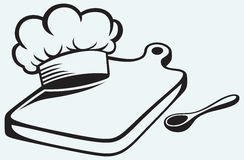 Het koken. Scherpe raad, chef-kokhoed en lepel Royalty-vrije Stock Foto