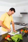 Het koken van de mens Stock Foto's