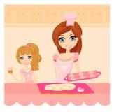 Het koken van de moeder en van de dochter in de keuken Stock Foto