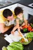 Het koken van de vader en van de zoon Stock Afbeelding