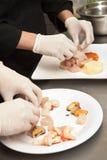 Het koken van handen Royalty-vrije Stock Afbeeldingen