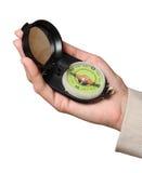 Het kompas van de toerist in een vrouwelijke hand Royalty-vrije Stock Afbeelding