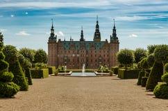 Het koninklijke kasteel van Frederiksborg, Hillerod, Denemarken stock foto's
