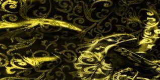 het Koninklijke monogram van de zijdedoek Geel is donker Dit is een zwarte zijde royalty-vrije stock fotografie