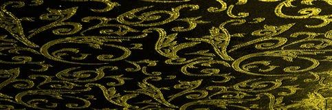 het Koninklijke monogram van de zijdedoek Geel is donker Dit is een zwarte zijde stock afbeelding