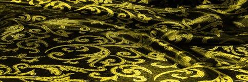 het Koninklijke monogram van de zijdedoek Geel is donker Dit is een zwarte zijde stock afbeeldingen