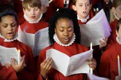 Het koor voert Kerstmishymnes uit Royalty-vrije Stock Foto