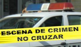 Het kordonband van de misdaadscène in het Spaans Stock Foto