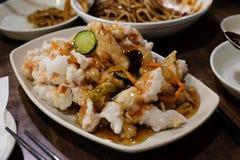 Het Koreaanse zoete en zure gebraden varkensvlees van tangsuyuk/ Stock Afbeelding