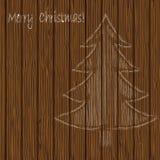 Het krijt van de kerstboomtekening op een achtergrond van houten planken royalty-vrije illustratie