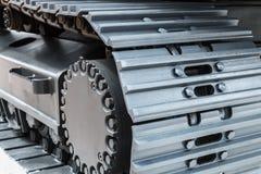 Het kruippakje volgt hydraulica op een tractor of een graafwerktuig royalty-vrije stock foto